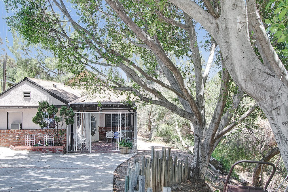 1905 Cottage on Wooded Lot at 4928 Avoca Street